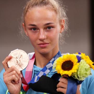 перша медаль на олімпіаді