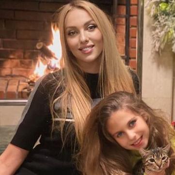 Оля Полякова и ее дочка
